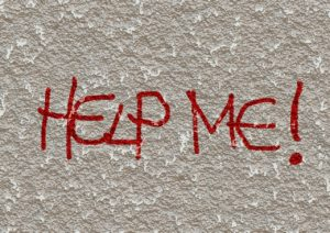 "Grafitti saying ""help me"""