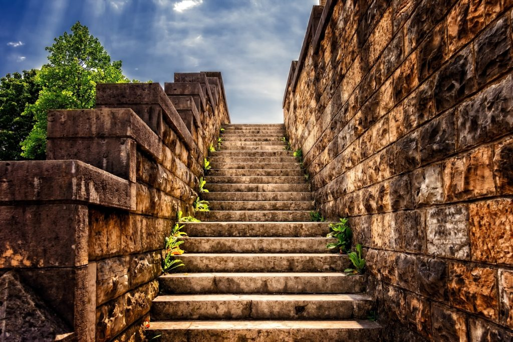 Stone steps ascending. Take the first step.