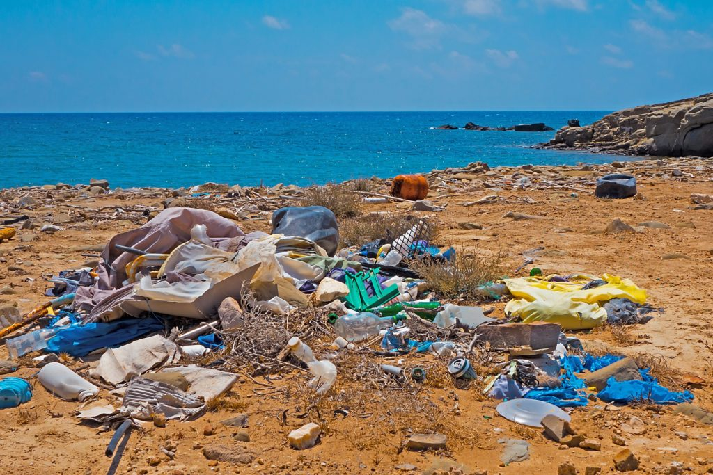 plastic pollution on a sandy beach