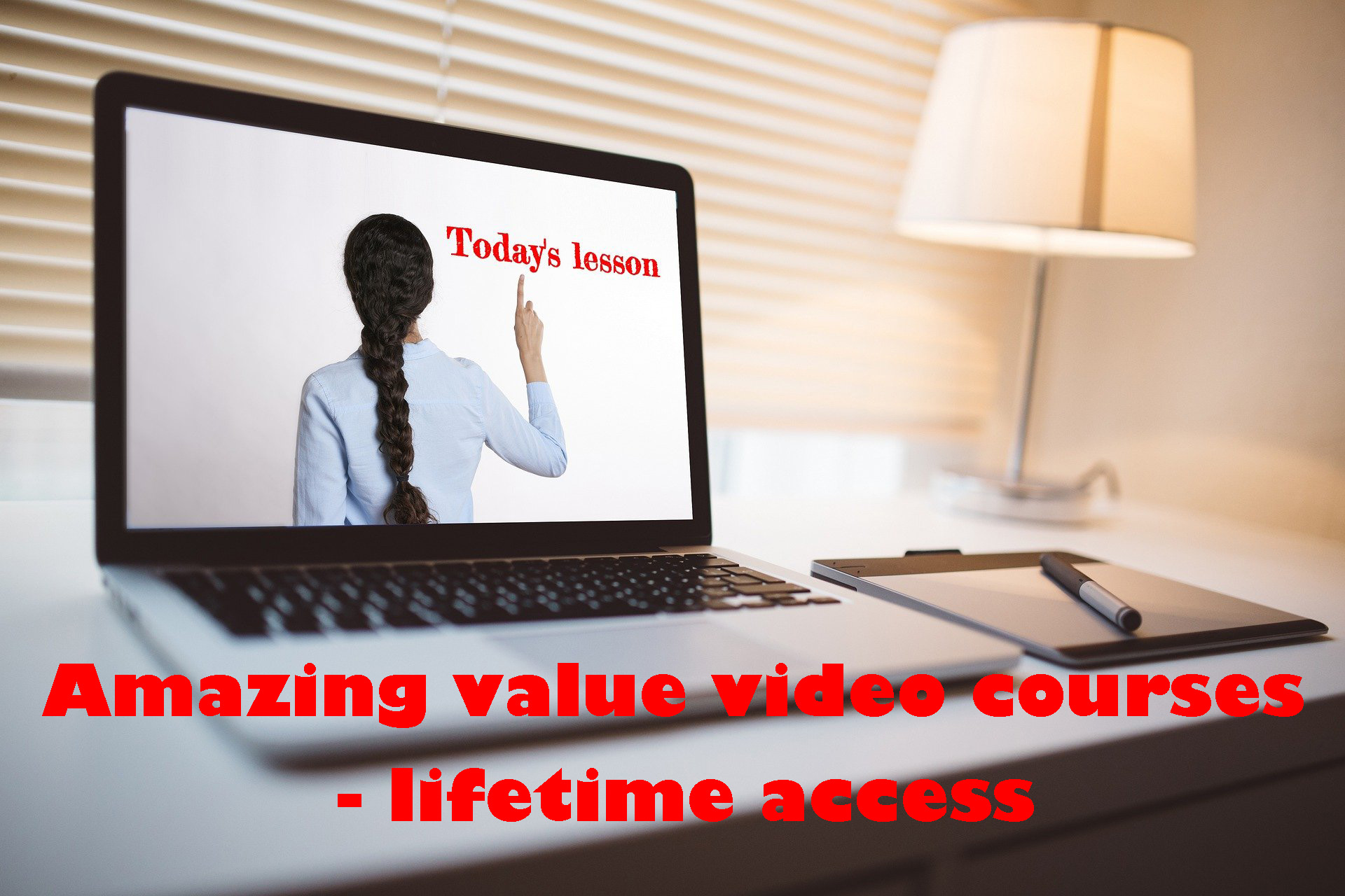 """Laptop open to show the back of a woman with a long plait, pointing at red text reading """"Today's lesson"""". Overlay of red text reading, """"Amazing value video courses - lifetime access""""."""""""